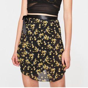 A small yellow and black chiffon wrap skirt